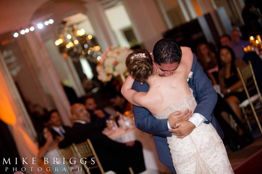 romantic Florida wedding A Chair Affair gold Chiavari chairs couple hug