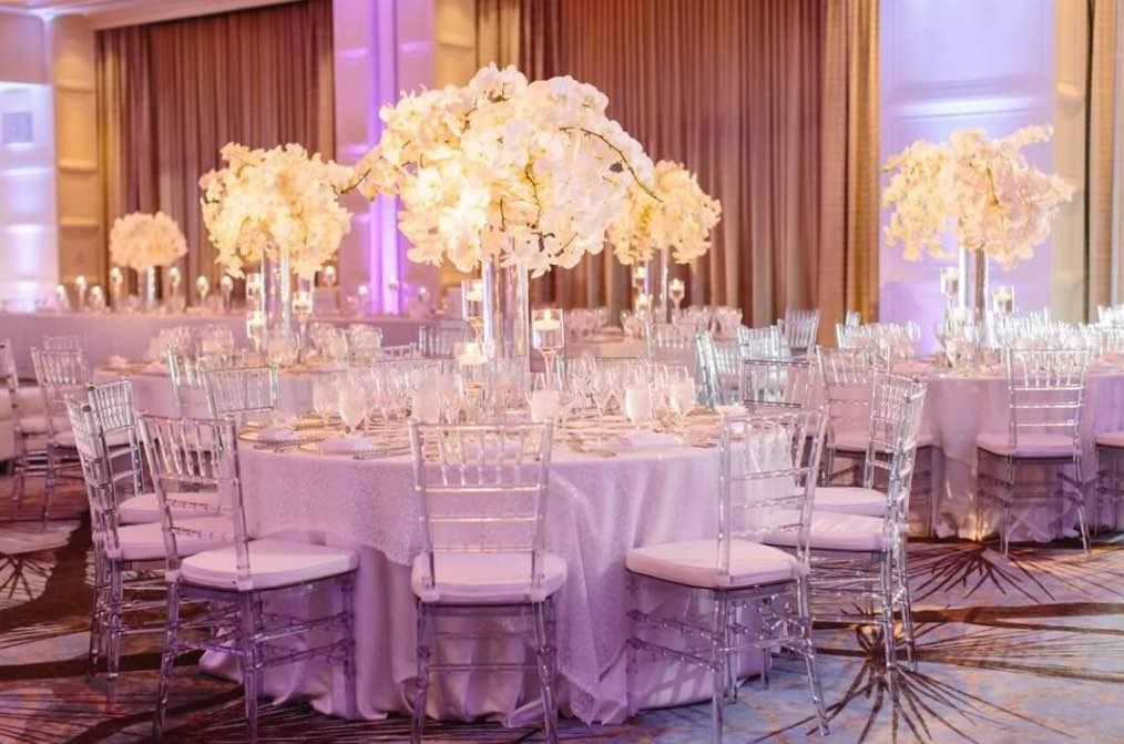 Floral Decor Reception Table with Clear Chiavari Chairs Greenery Productions A Chair Affair