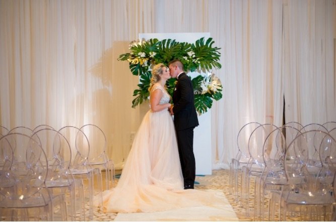 Modern Gold Ballroom Wedding Shoot A Chair Affair Couple with Ghost Chairs