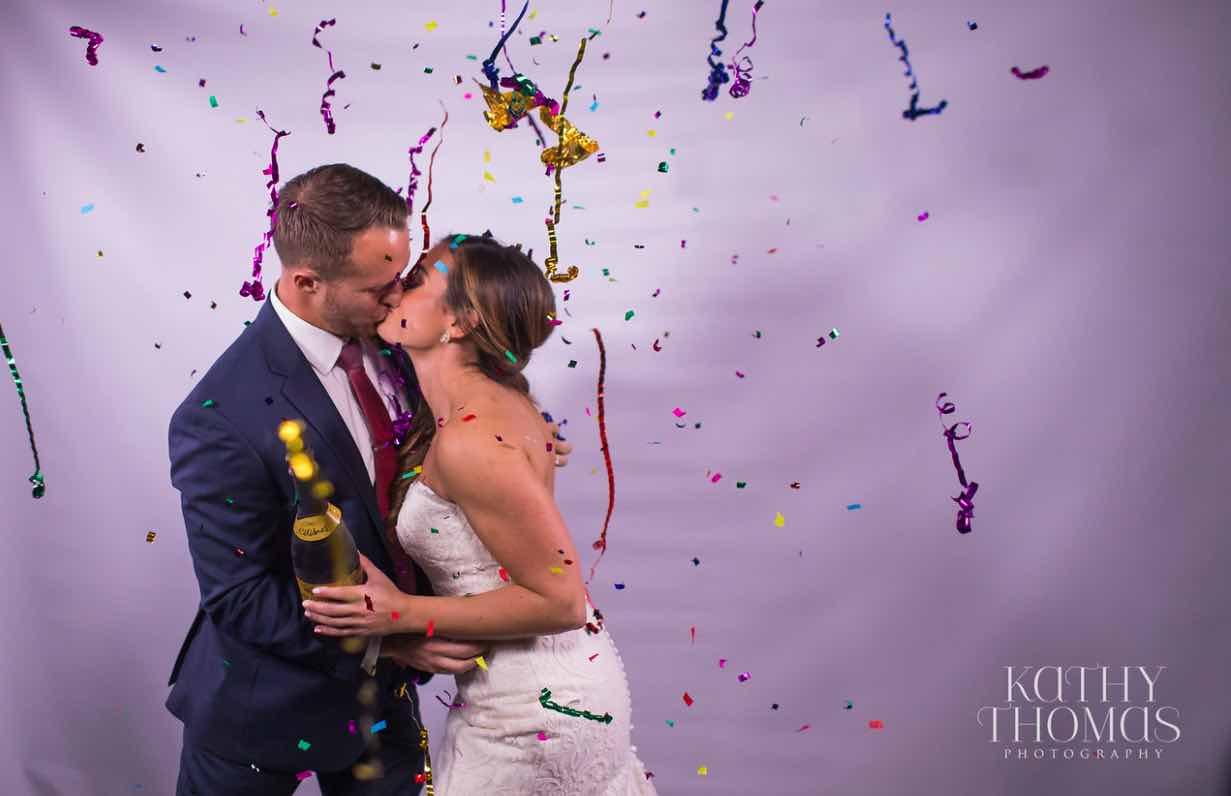 Alexa and Derek luxury Ritz Carlton wedding A Chair Affair couple confetti