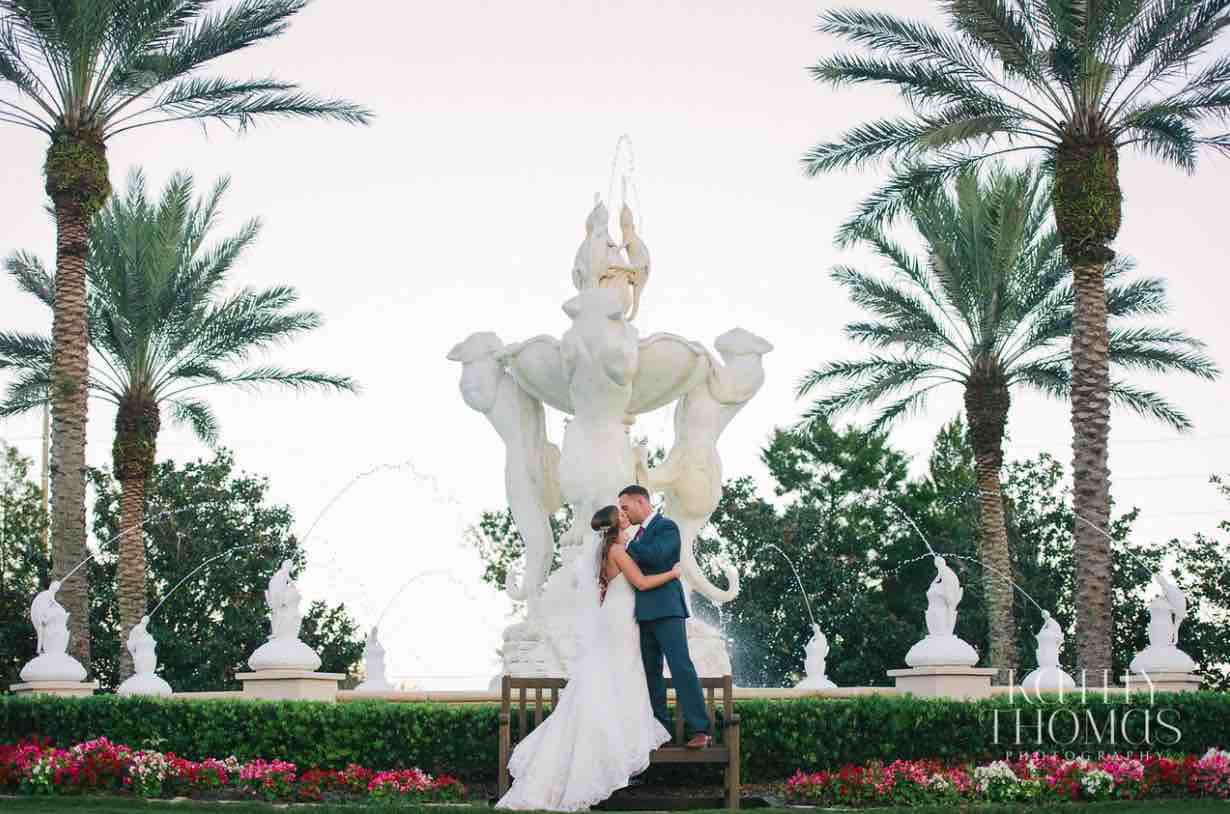 Alexa and Derek luxury Ritz Carlton wedding A Chair Affair couple posing