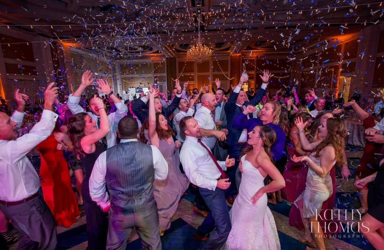 Alexa and Derek luxury Ritz Carlton wedding A Chair Affair dancing with confetti