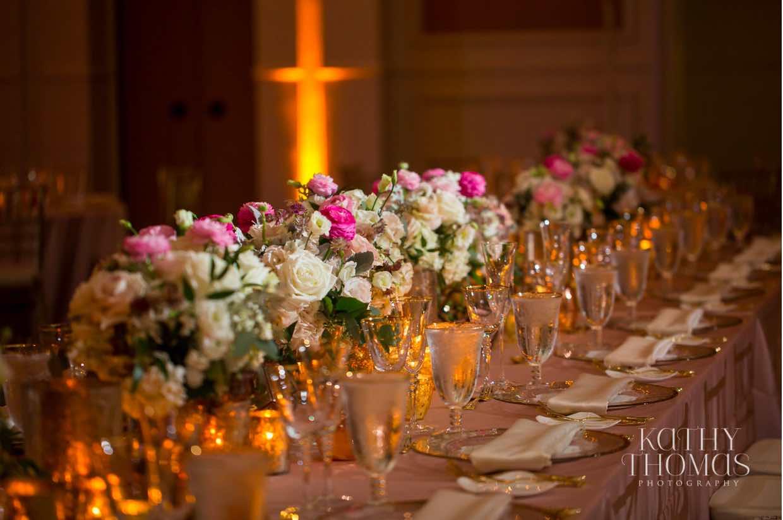 Alexa and Derek luxury Ritz Carlton wedding A Chair Affair gold rim stemware ballroom