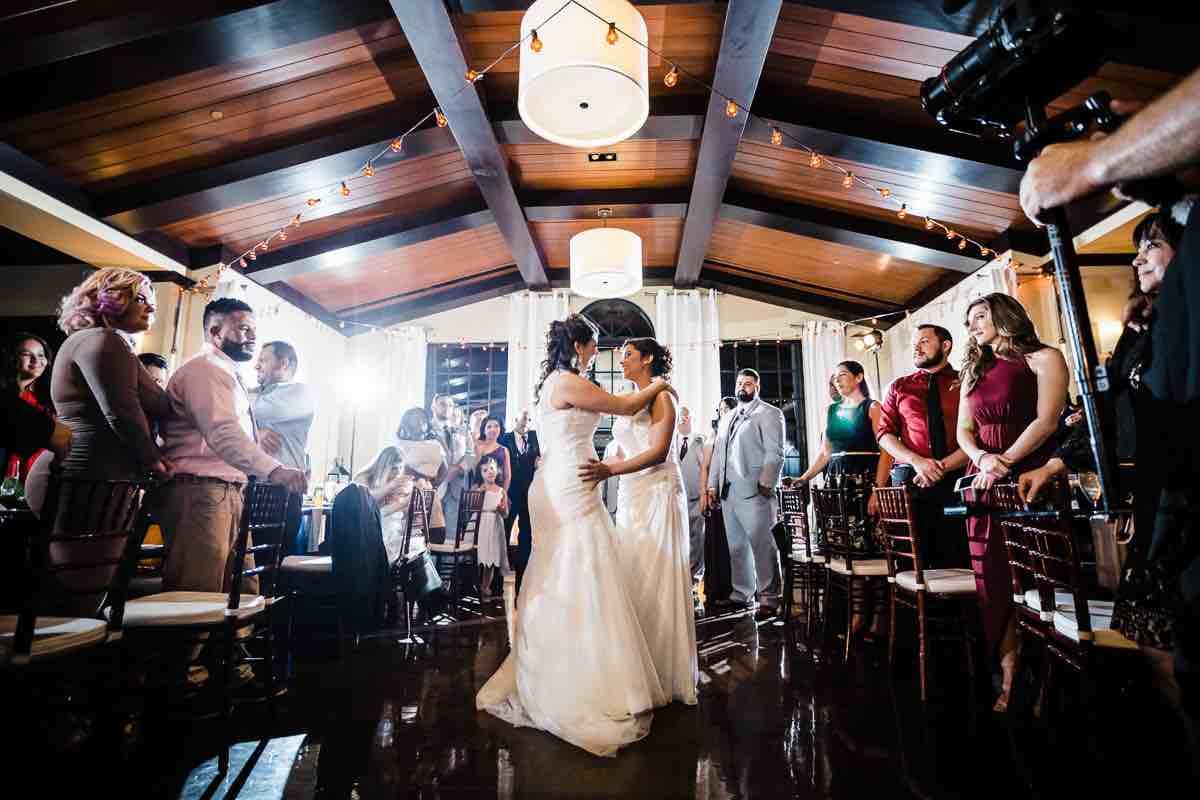 intimate LGBT wedding Reunion Resort A Chair Affair mahogany Chiavari chairs brides on dance floor