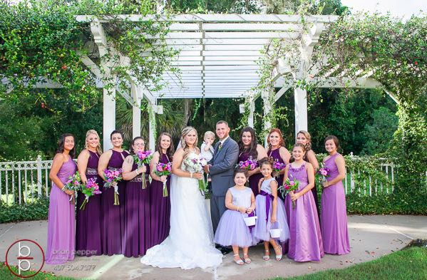 Lake Mary Events Center dreamy purple wedding Emile and Brandon A Chair Affair newlyweds with bridal party