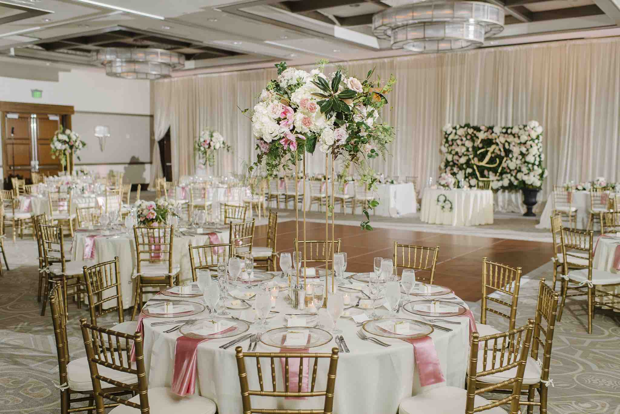 Alfond Inn wedding Winter Park A Chair Affair table with gold rim chargers and brushed gold flatware Sunglow Photography