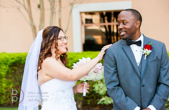 Rosen Shingle Creek Resort Wedding with Ivory and Berry Mary and Brandon A Chair Affair Couple Posing