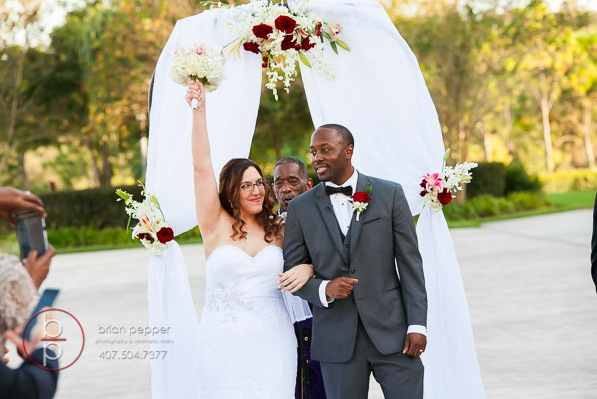 Rosen Shingle Creek Resort Wedding with Ivory and Berry Mary and Brandon Ceremony A Chair Affair garden wedding arch