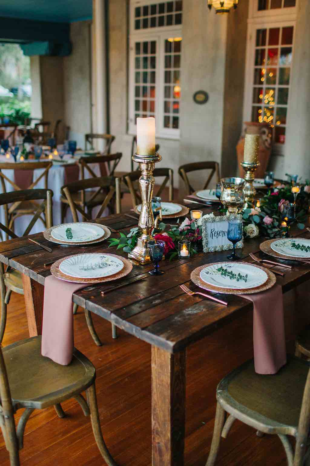 romantic Sydonie Mansion wedding Shelbie and Justin Reception French Country Chairs Farm Table Napkins and Rose Gold Chargers A Chair Affair