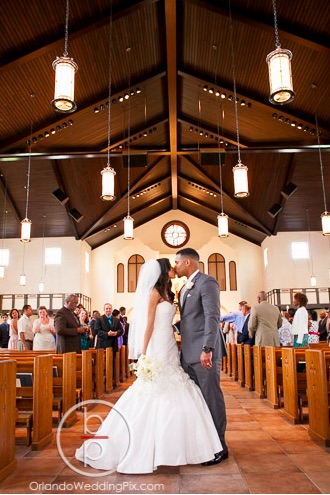 Alyssa and Claudel Lake Mary Wedding A Chair Affair Couple Ceremony All Souls Catholic Church