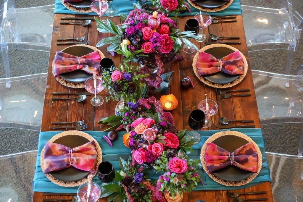 Isla del Sol Wedding Shoot-A Chair Affair-farm table-rose gold charger-black china-black goblets-black flatware