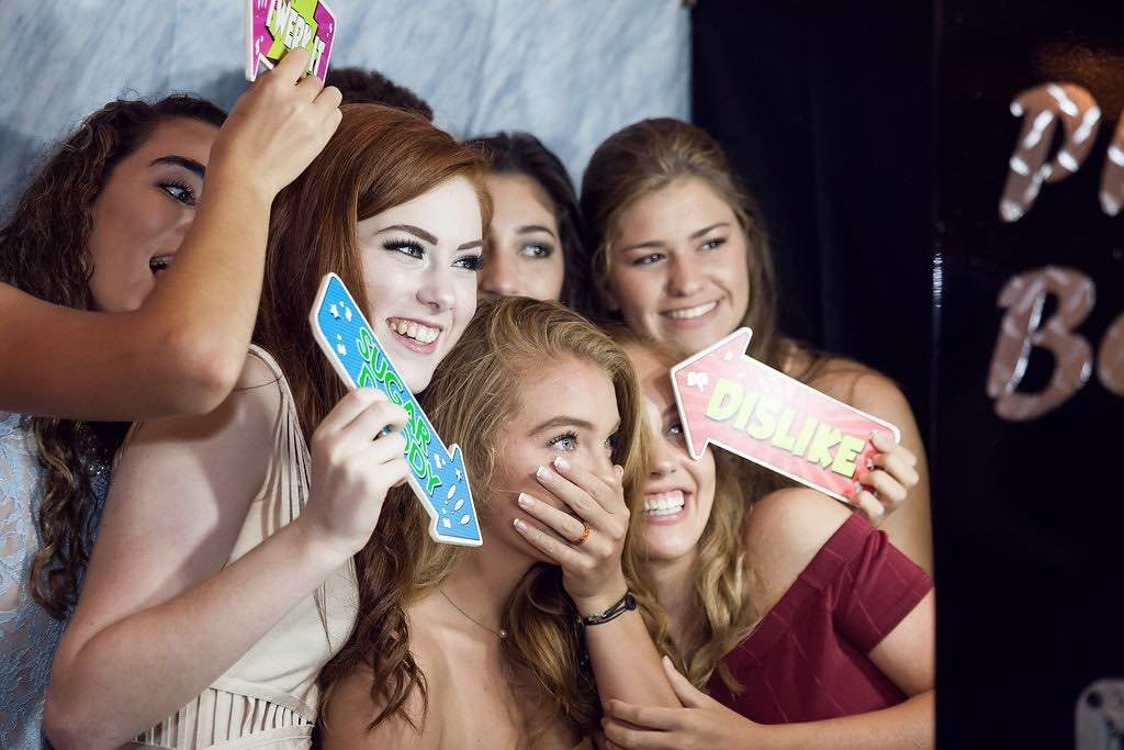 Traditional Birthday Celebration Four Seasons Orlando Quinceanera Girls at Photobooth Our Photobooth Rocks A Chair Affair Marta Boschmann Photography