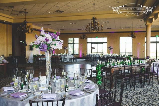 Bella Collina Wedding Reception A Chair Affair Silver Belmont Chargers and Mahogany Farm Tables William Arthur Photography