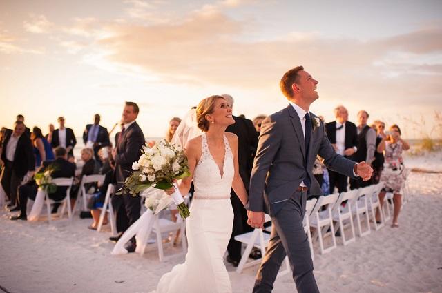 Carlouel Yacht Club Old Florida Wedding-Beach Ceremony Bride and Groom-White Folding Chairs-A Chair Affair