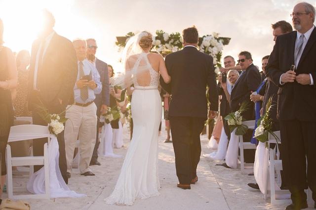 Carlouel Yacht Club Old Florida Wedding-Beach Ceremony Processional-White Folding Chairs-A Chair Affair