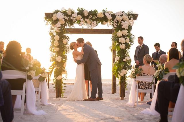 Carlouel Yacht Club Old Florida Wedding-Beach Wedding Kiss-White Folding Chairs-A Chair Affair