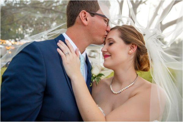Davis Island Garden Club Outdoor Wedding-Bride and Groom Kiss- A Chair Affair