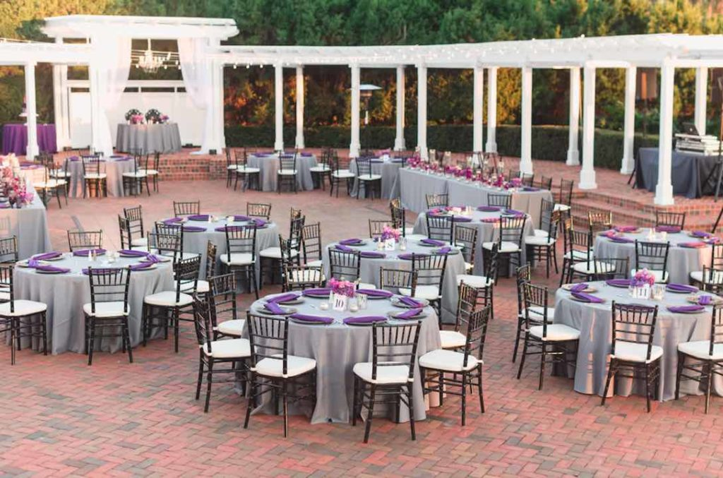 Rafael and Matt winter Cypress Grove Estate Wedding LGBT Wedding A Chair Affair black Chiavari chairs with ivory pads and black deco chargers Captured by Elle