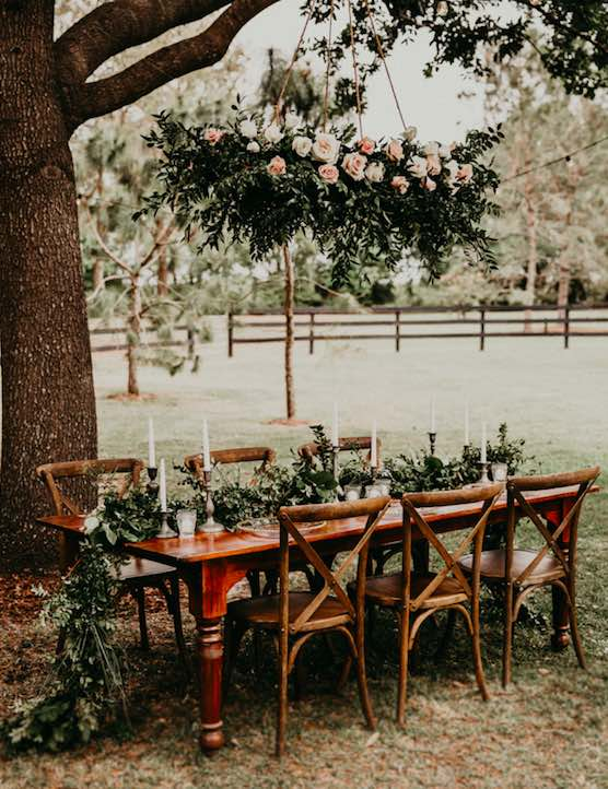 country chic wedding A Chair Affair French Country Chairs with greenery and candles, specialty seating, specialty chairs