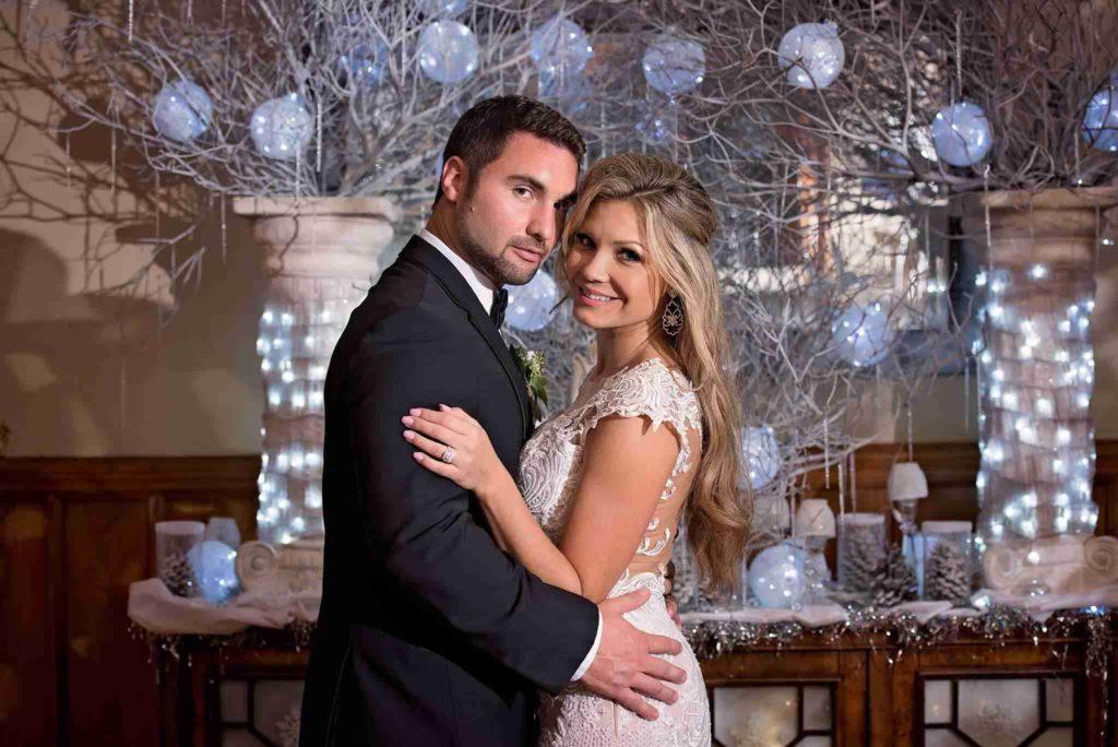 stetson mansion a chair affair bride and groom posing