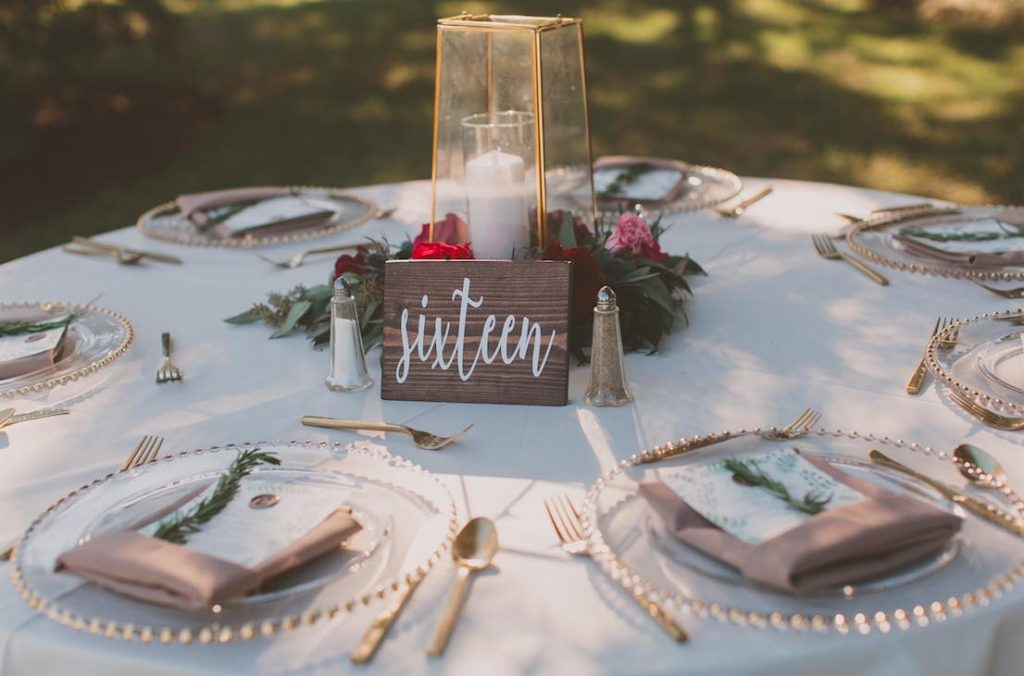 Intimate Garden Wedding at Davis Island Garden A Chair Affair Reception Gold Belmont Chargers and Gold Flatware