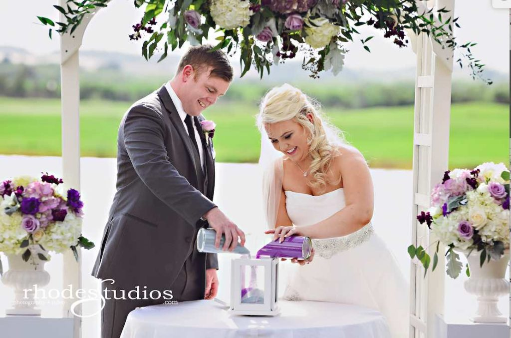 Purple and Silver wedding at Omni Resort A Chair Affair couple ceremony sand