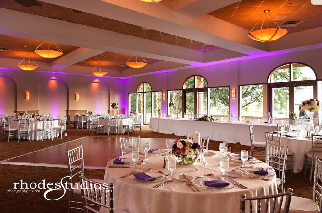 Purple and Silver wedding at Omni Resort A Chair Affair silver Chiavari chairs and silver belmont chargers at reception with amethyst napkins