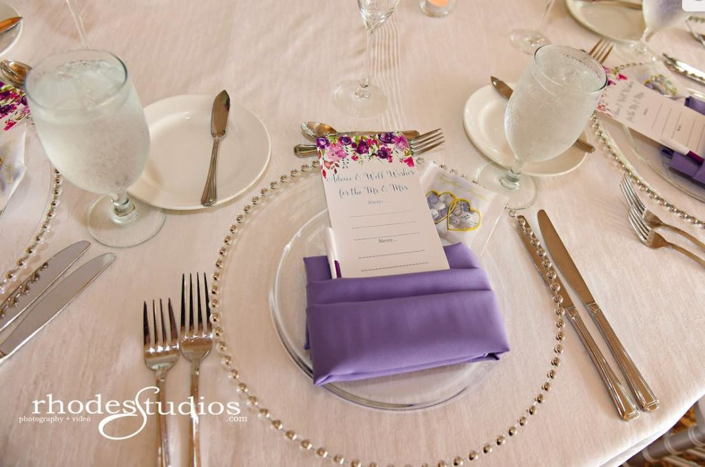 Purple and Silver wedding at Omni Resort A Chair Affair silver belmont chargers at reception with amethyst napkins