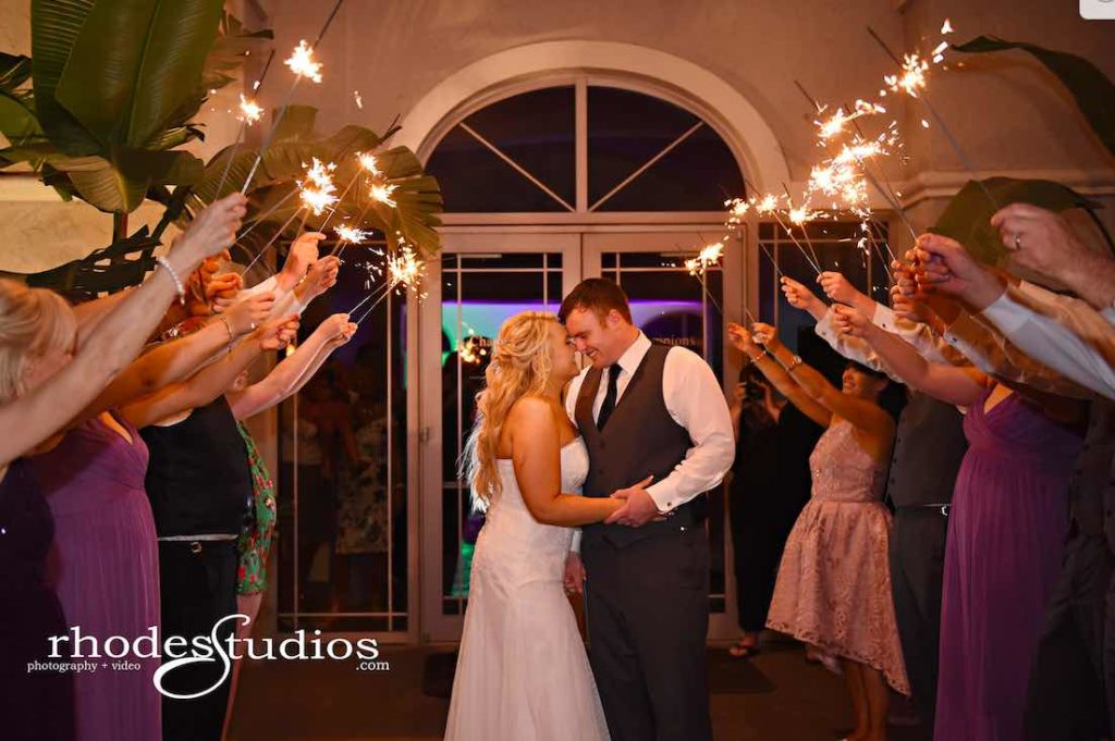 Purple and Silver wedding at Omni Resort Couple sparkler sendoff