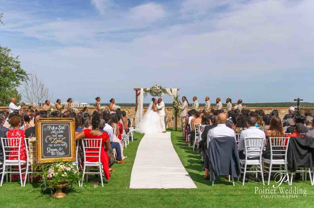 Valisha and Philip Pastel and Gold Bella Collina Wedding A Chair Affair White Chiavari Chairs at ceremony with guests and couple
