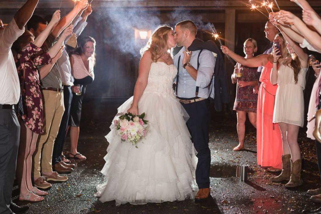 hammock house a chair affair bride and groom kiss exit