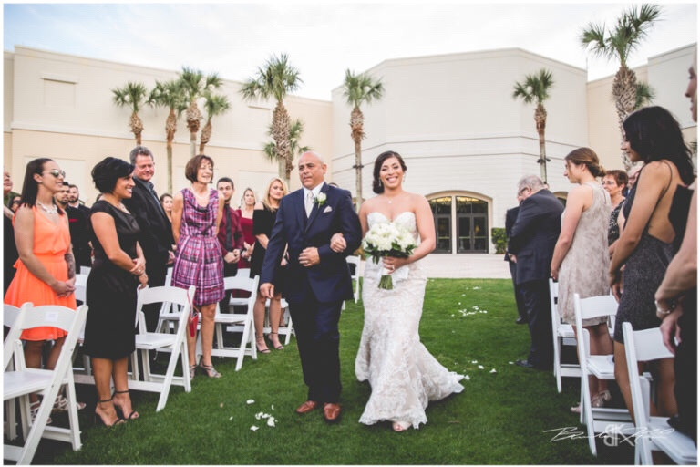 Cream and champagne Orlando wedding Omni Resort at Championsgate Brandon Kari Productions A Chair Affair white resin folding chairs at ceremony