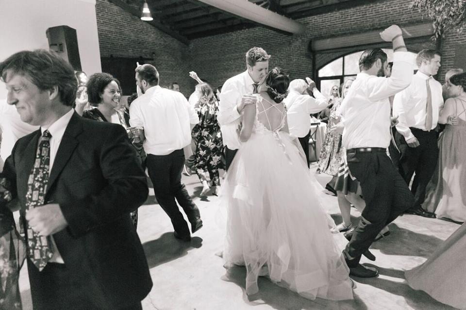 morean center a chair affair bride and groom kiss bw