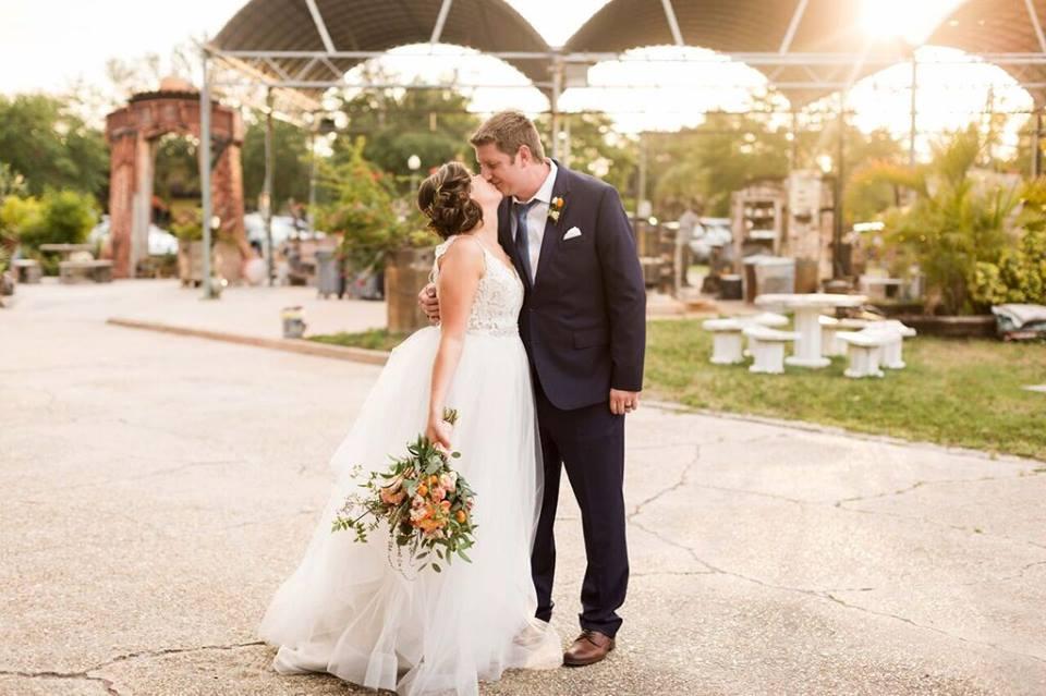 morean center a chair affair bride and groom kiss outside