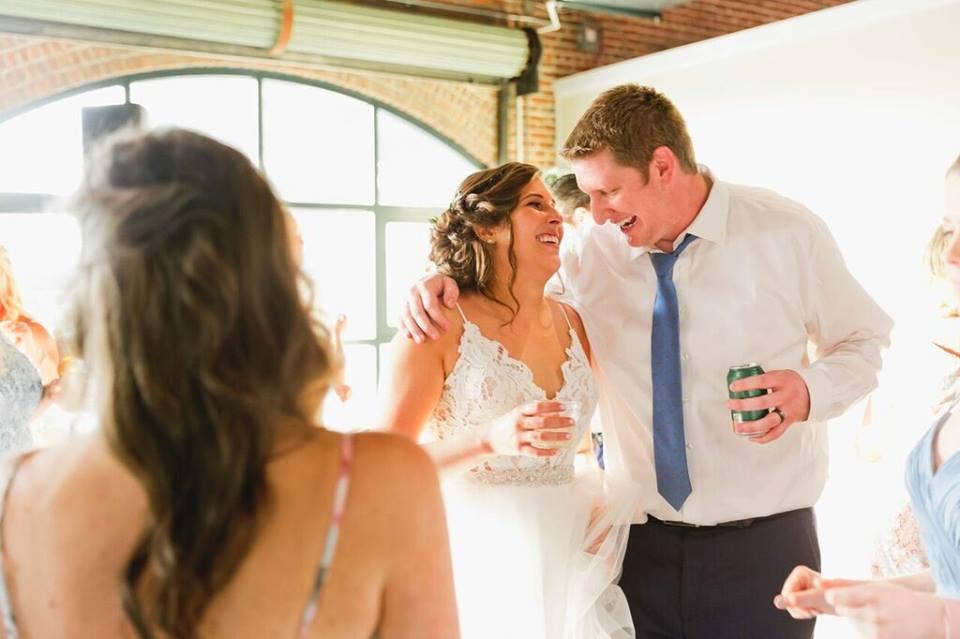 morean center a chair affair bride and groom laughing