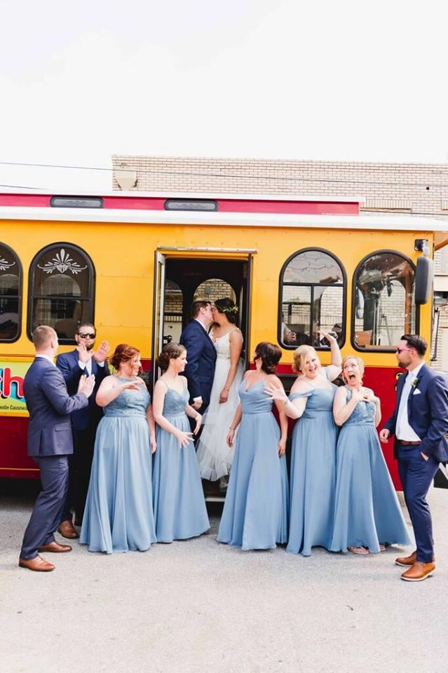 morean center a chair affair bride and groom trolley