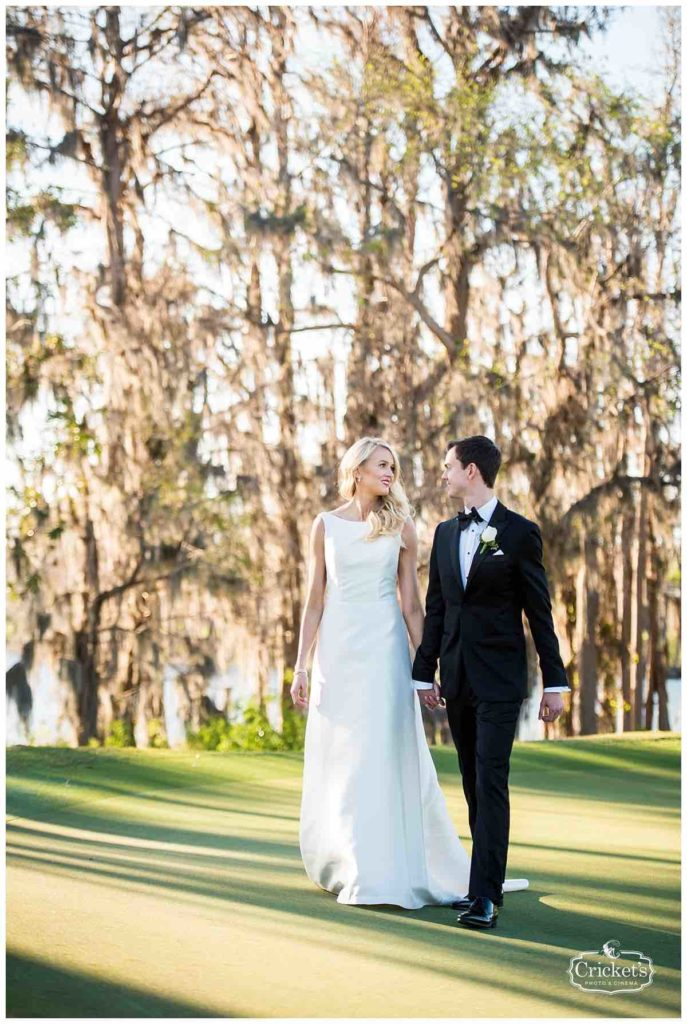 Isleworth Country Club Wedding Classic White Wedding Crickets Photo A Chair Affair Couple Hand in Hand