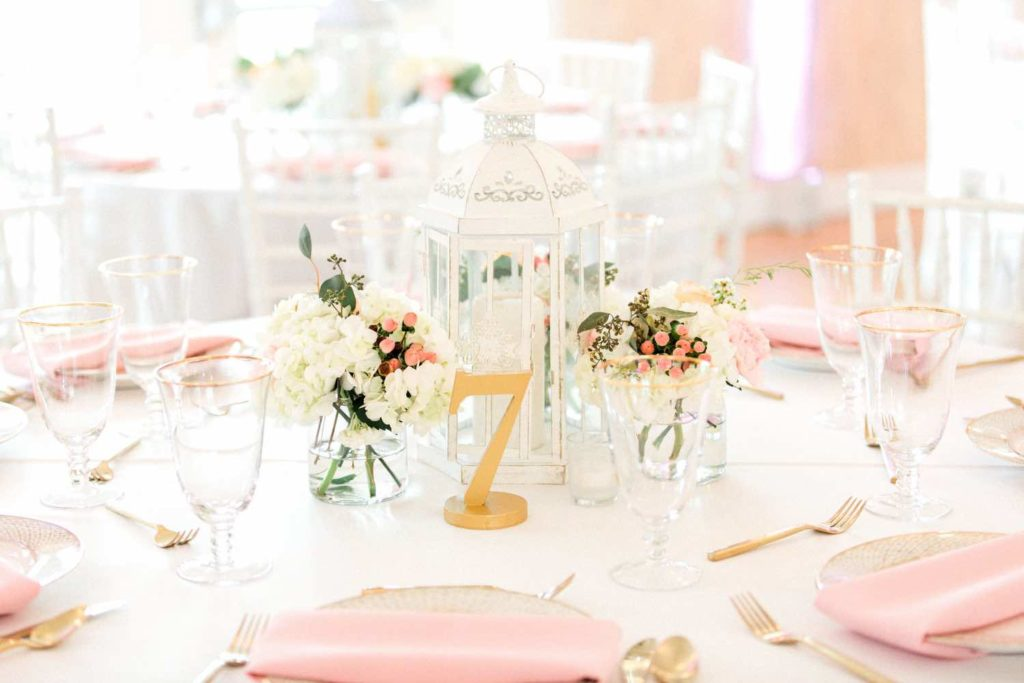 The Banyan Estate Blush and Ivory Wedding Flora Bloom Photography A Chair Affair gold brushed flatware and gold rimmed stemware