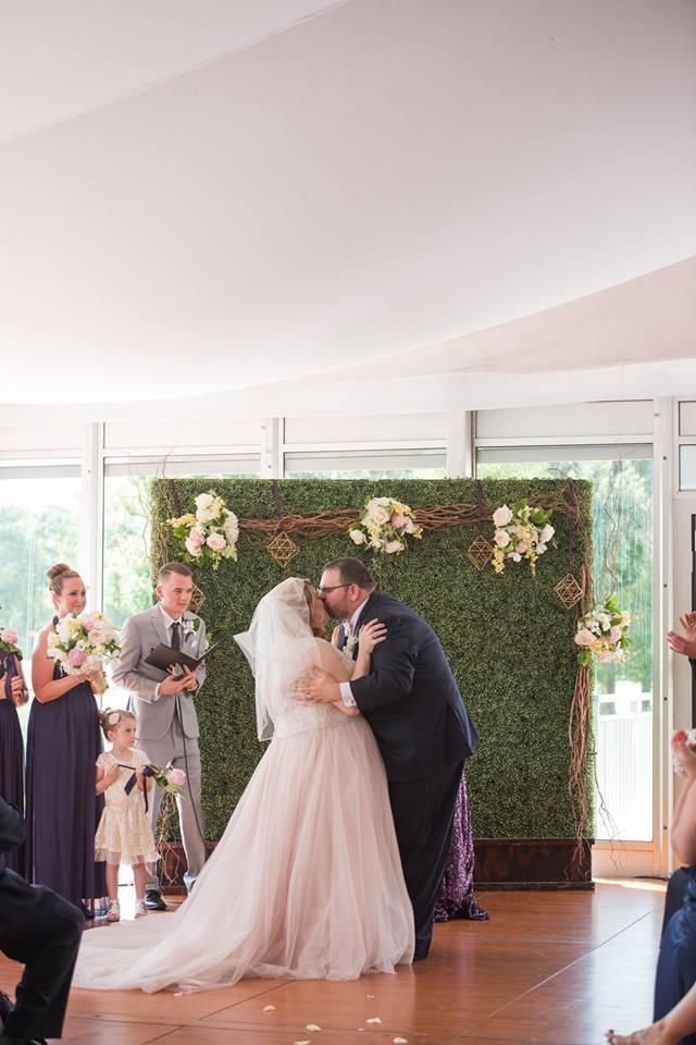 playful hilton orlando bonnet creek wedding a chair affair kiss hedge wall