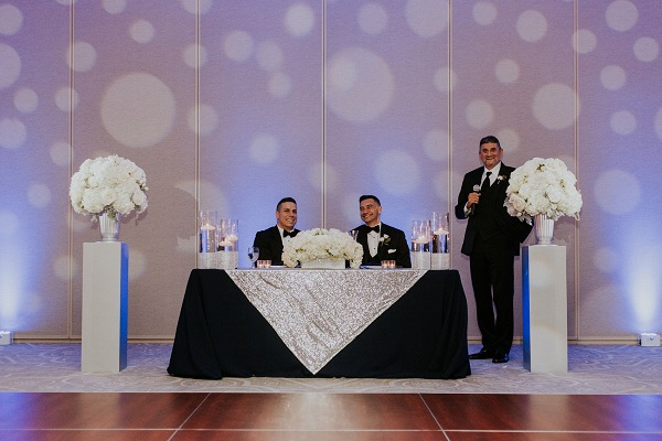 Alfond-Inn-Wedding-A-Chair-Affair-LGBT-Wedding-Silver-Glitter-Rim-Sprial-Chargers-Navy-Linens-Sweetheart-table
