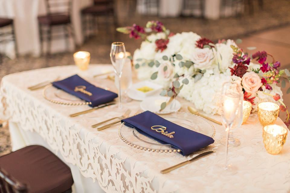 Gold Bella Collina Wedding A Chair Affair belmont chargers brushed gold flatware
