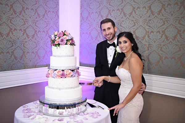Reunion-Resort-Jewish-Wedding-A-Chair-Affair-Rhodes-Studios-cake-cutting.jpg