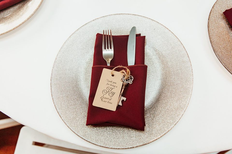 Sydonie Mansion Wedding A Chair Affair champagne glitter glass chargers linens napkins