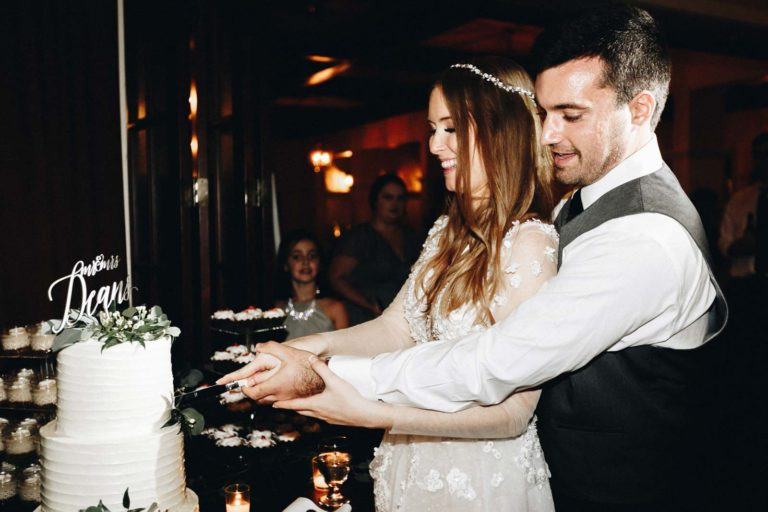 Cutting the Ivory and Green Wedding Cake