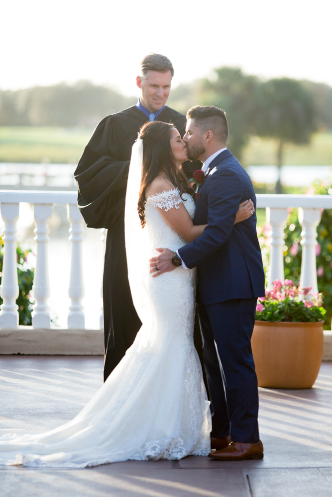 Bride and Groom First Kiss at Mission Inn Wedding
