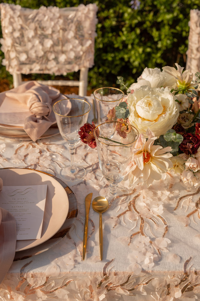 gold rimmed stemware surrounded with floral