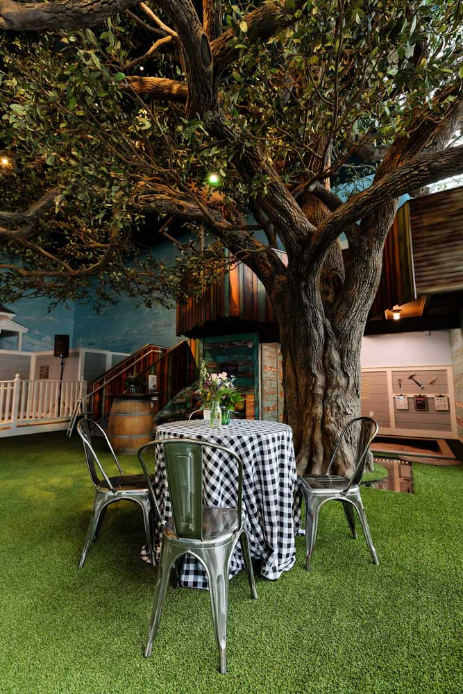 Round Table and Tolix Chairs under Tree