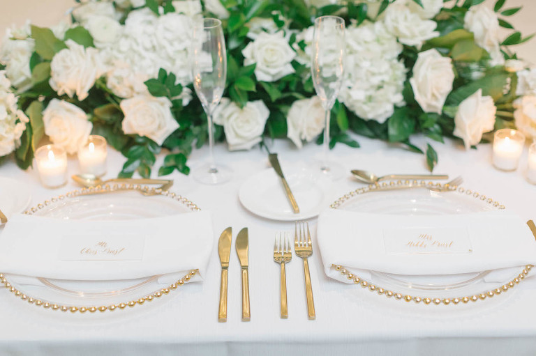 Wedding Reception gold and white place settings